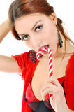 Sexy woman licking lollipop. Royalty Free Stock Photos