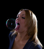Sexy woman licking soap bubble Stock Photos