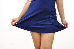 Sexy woman lifts up short dress. Isolated woman lifts up sexy dress and reveals her legs Stock Images