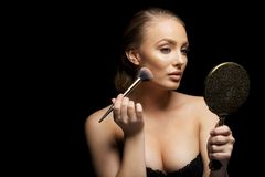 Sexy woman in lingerie applying foundation Royalty Free Stock Photos