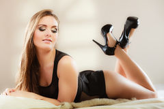 Sexy woman in lingerie on carpet Royalty Free Stock Image