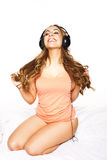 Sexy woman listening to music Royalty Free Stock Images