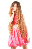 sexy woman with long curly hair in pink dress Royalty Free Stock Images