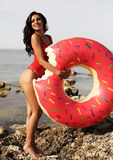 Woman with long dark curly hair wearing bikini and beach cl. Fashion outdoor photo of gorgeous woman with long dark curly hair wearing bikini and beach clothes royalty free stock image