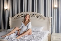 Woman with long hair in amazing clothes. Beautiful woman in amazing clothes posing in hotel stock photos