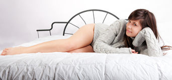 Sexy Woman With Long Legs On Bed Stock Image
