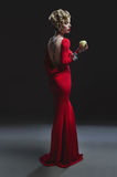 Sexy woman in long red dress Stock Image
