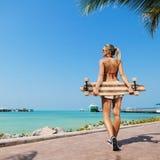 Sexy woman and  longboard Stock Photo