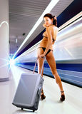 Sexy woman with luggage in subway Stock Images