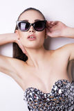 Sexy woman in luxurious corset and sunglasses Royalty Free Stock Image