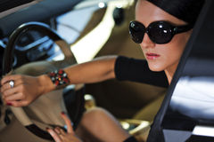 woman in luxury car Stock Images