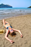 woman is lying on the beach Royalty Free Stock Images