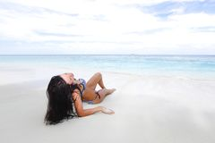 Sexy woman lying on the beach Royalty Free Stock Image