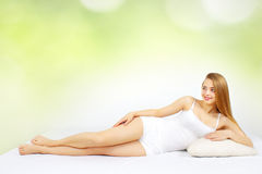 Sexy woman lying on the bed Royalty Free Stock Image