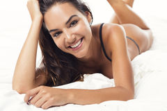 Sexy woman lying on the bed Royalty Free Stock Photos