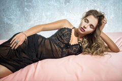 Sexy woman lying in the bed Royalty Free Stock Photos