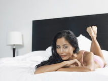 Sexy Woman Lying In Bed Royalty Free Stock Photo