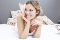 Sexy woman lying in bed Stock Images
