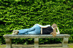 Sexy woman lying on the bench Stock Photos