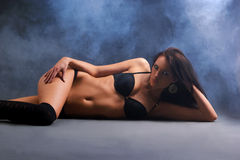 A sexy woman lying in erotic lingerie Royalty Free Stock Photos