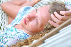 Sexy woman is lying in hammock closeup Stock Photo