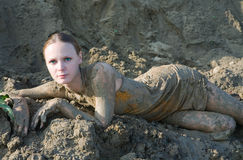 Sexy woman lying in the mud Stock Photos