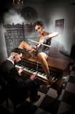 Sexy woman lying in the piano Stock Photos