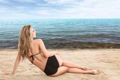 Sexy woman lying on sand Royalty Free Stock Photo