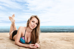 Sexy woman lying on sand Stock Photos