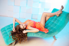 Sexy woman lying on sofa in luxury interion. Sexy beautiful girl Royalty Free Stock Photography