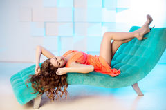 Sexy woman lying on sofa in luxury interion. Sexy beautiful girl Stock Photography