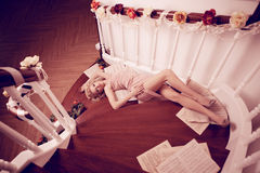 Sexy woman lying on the stairs Stock Photos