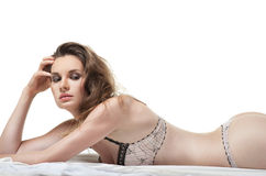 Sexy woman lying on the white bed Royalty Free Stock Photos