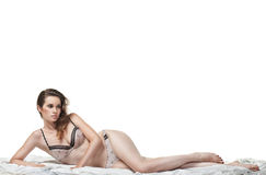 Sexy woman lying on the white bed Royalty Free Stock Photography