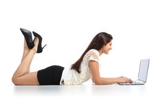 Sexy woman lying working with a laptop Stock Photos