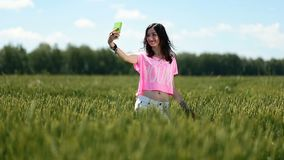 woman making a self portrait in the field stock footage