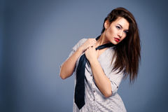 woman in a man's shirt and tie Stock Photo