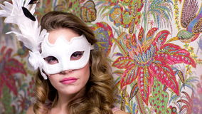 Woman mask bed. Beautiful female with venetian carnival mask in a lounge or boudoir setting. Useful for parties, clubs, events and fashion stock video footage