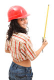 Sexy woman with measure tape. Sexy young repair woman in helmet with a measure tape Stock Image