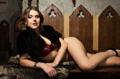 Sexy woman in a medieval castle interior. Portrait of the sexy woman in a medieval castle interior Stock Photography