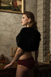Sexy woman in a medieval interior Royalty Free Stock Images
