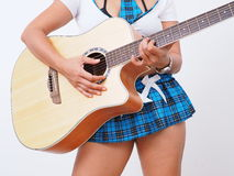 Sexy woman micro skirt plays the guitar Royalty Free Stock Photography