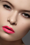 Sexy woman model with bright pink fuchsia lips makeup Stock Photography