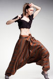 Sexy woman model posing in large (salwar) pants - boho-chic fashion Stock Image