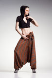 Sexy woman model posing in large (salwar) pants - studio fashion shot Stock Photos