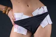 Sexy woman with money in the bikini Stock Images