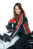 Sexy woman on motorcycle. Young sexy woman in a leather suit sitting on white motorcycle and holding a helmet Royalty Free Stock Photo