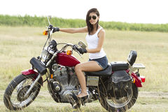 Sexy woman on a motorcycle in nature Royalty Free Stock Photos
