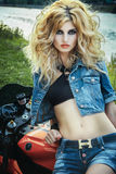 Sexy woman on a motorcycle Royalty Free Stock Images