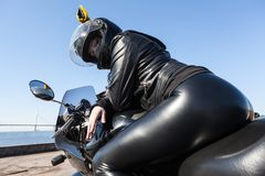 Free Sexy Woman Motorcyclist In Black Leather Apparel And Helmet Sitting On Bike, Rear View, Low Angle View Stock Photo - 145792760